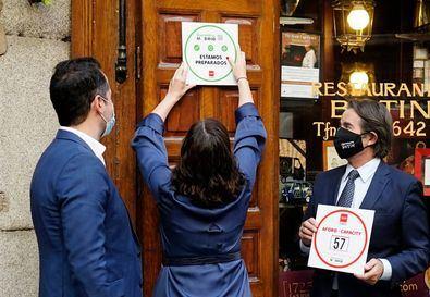 Los establecimientos que, como Casa Botín, obtengan el sello 'Garantía Madrid' recibirán un adhesivo para mostrar en un lugar visible de su acceso el límite de aforo del local acreditando su compromiso contra el coronavirus.